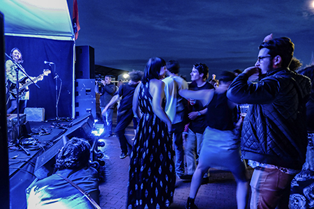 A crowd at a music gig at night