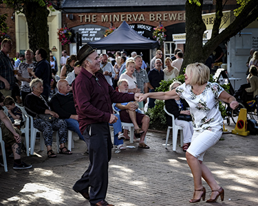 A man and woman dancing in front of a crowd